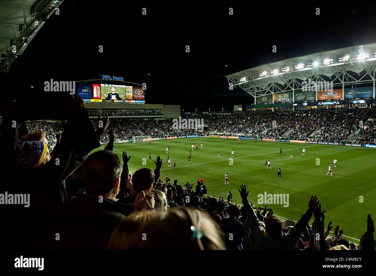 Philadelphia Union fans during MLS soccer match. - Stock Image