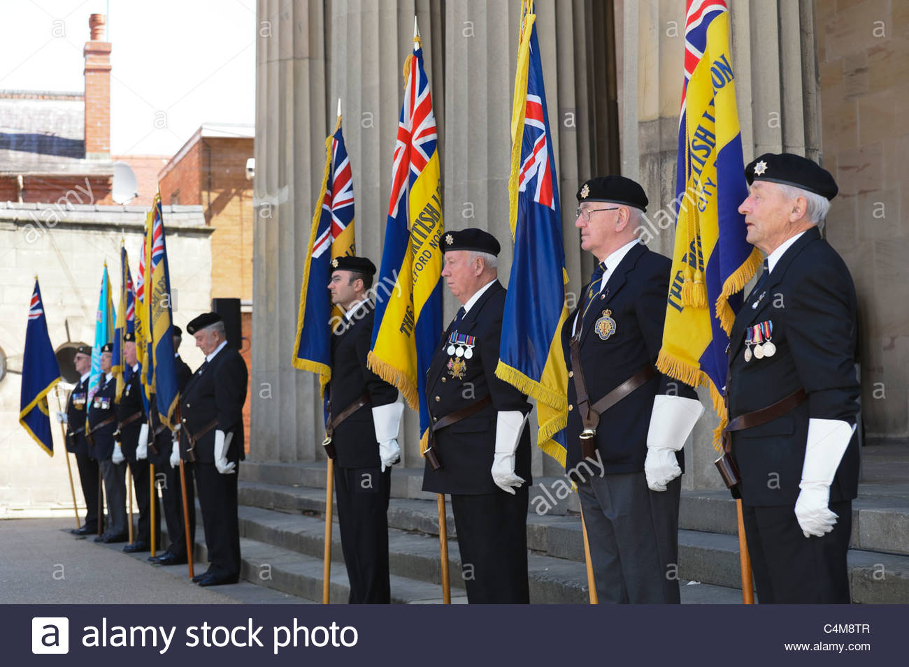 Royal British Legion ex-servicemen on parade outside the Shire hall, Hereford City, UK. Old soldiers wearing uniforms - Stock Image