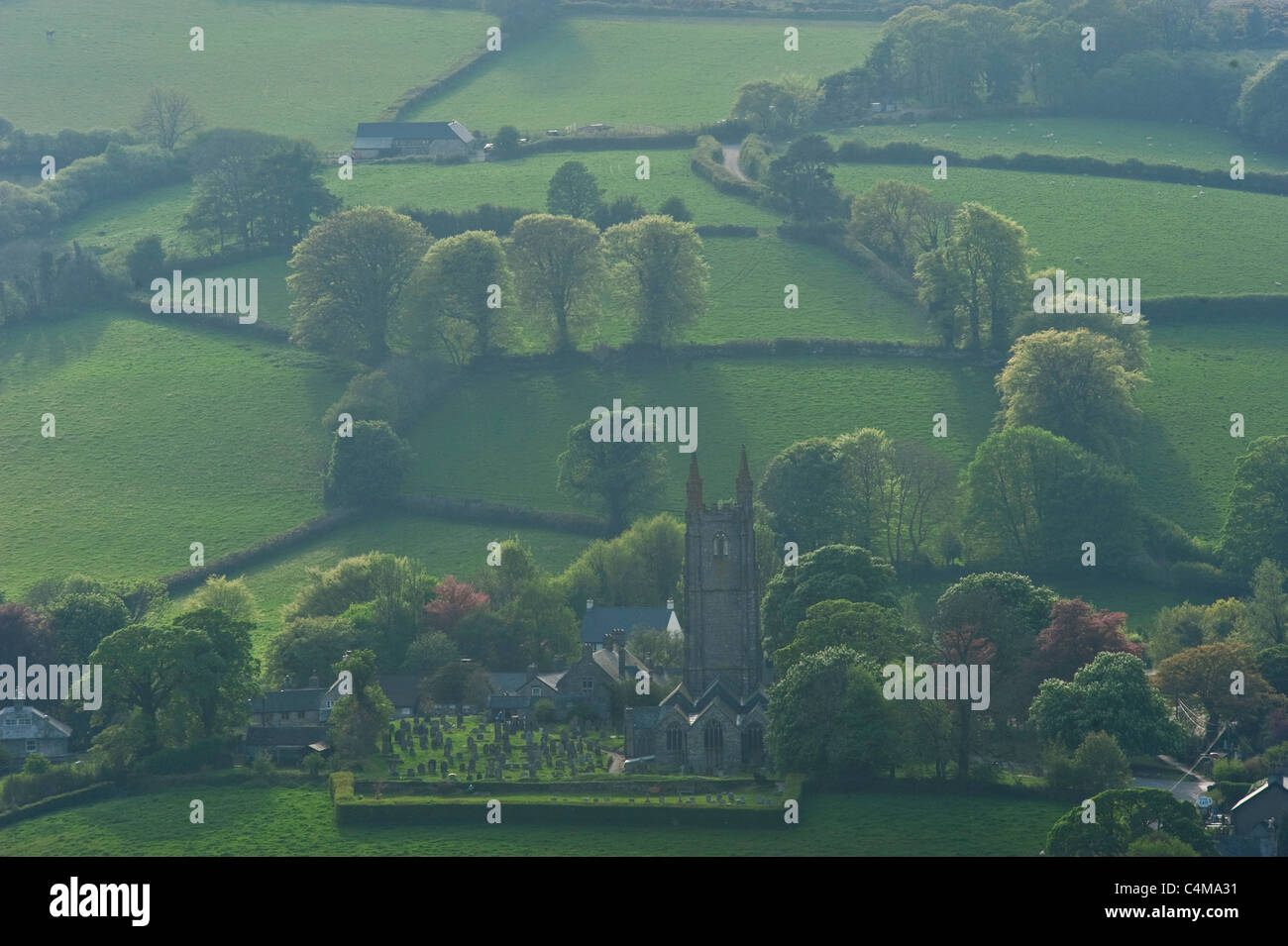 The 'Cathedral of the Moor' church in the village of Widecombe-in-the-Moor in Dartmoor National Park. - Stock Image