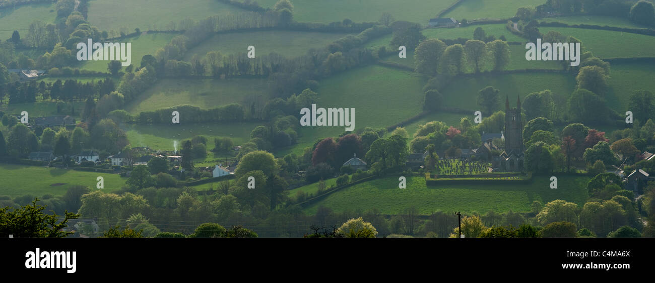 A 2 picture stitch panoramic of The 'Cathedral of the Moor' church in the village of Widecombe-in-the-Moor - Stock Image