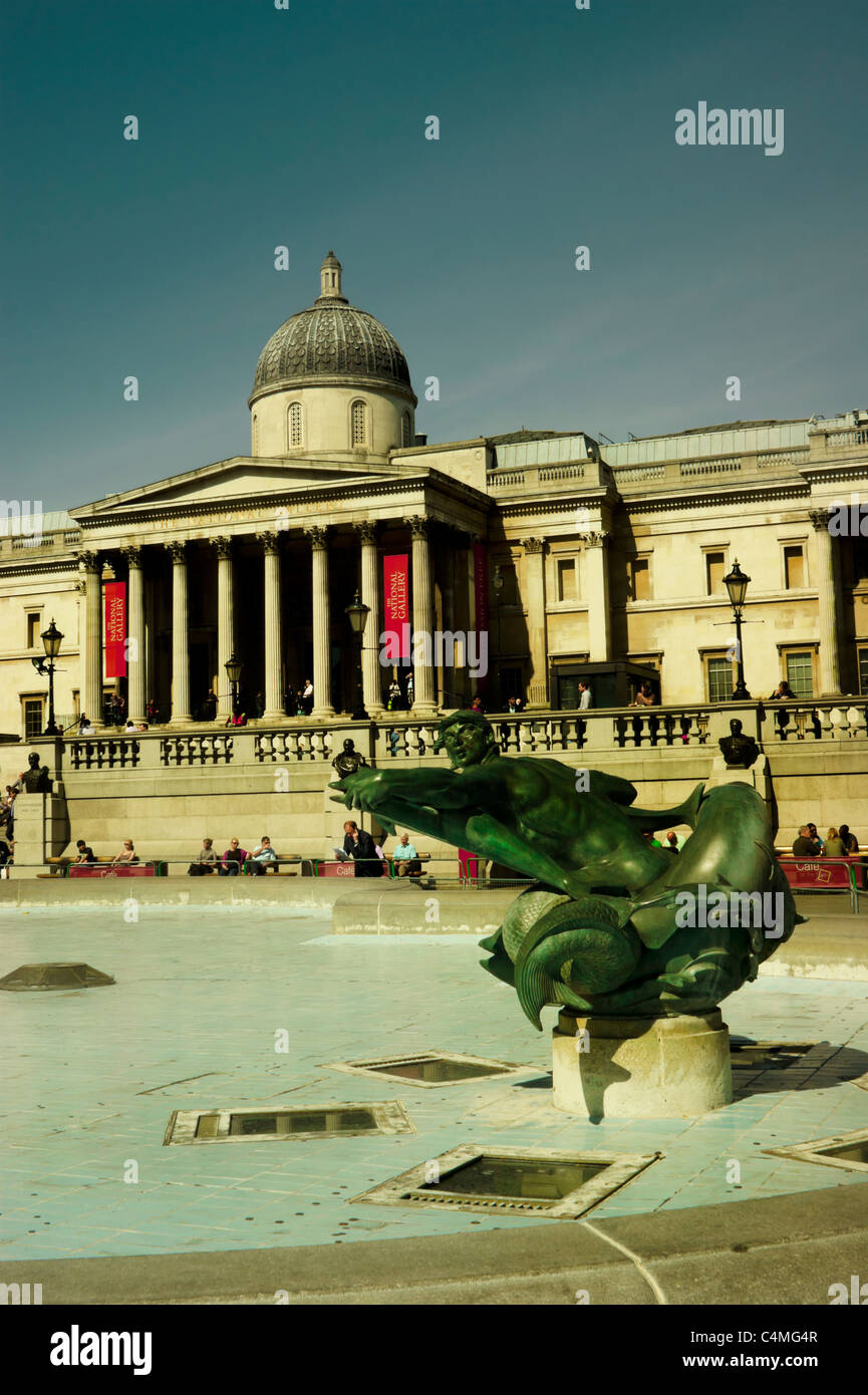 Trafalgar Square. Fountains emptied of water for cleaning with the National Gallery in the background. Stock Photo
