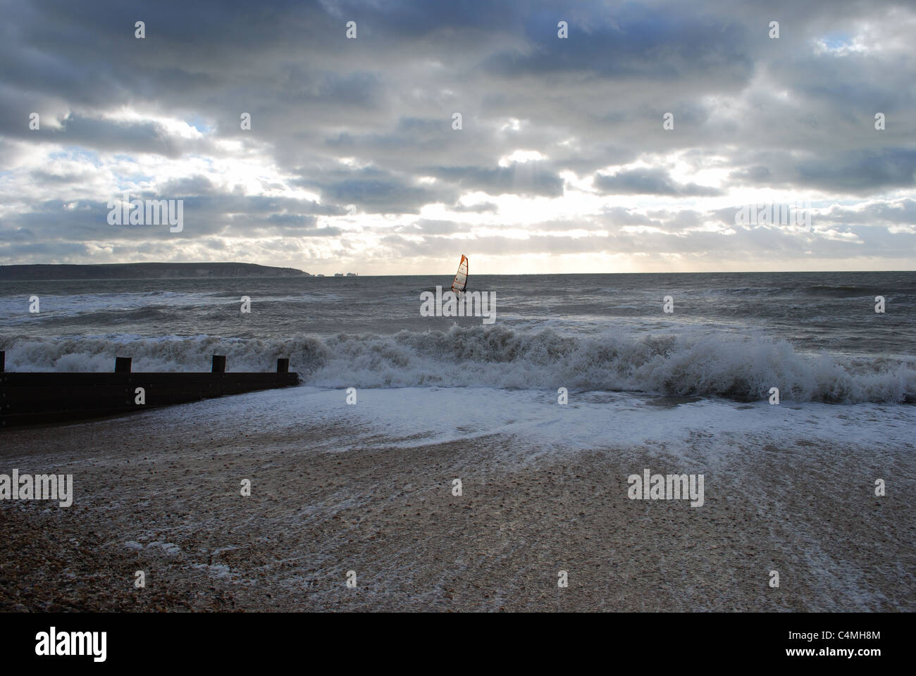 Winter wind surfing with the Needles in the background. - Stock Image