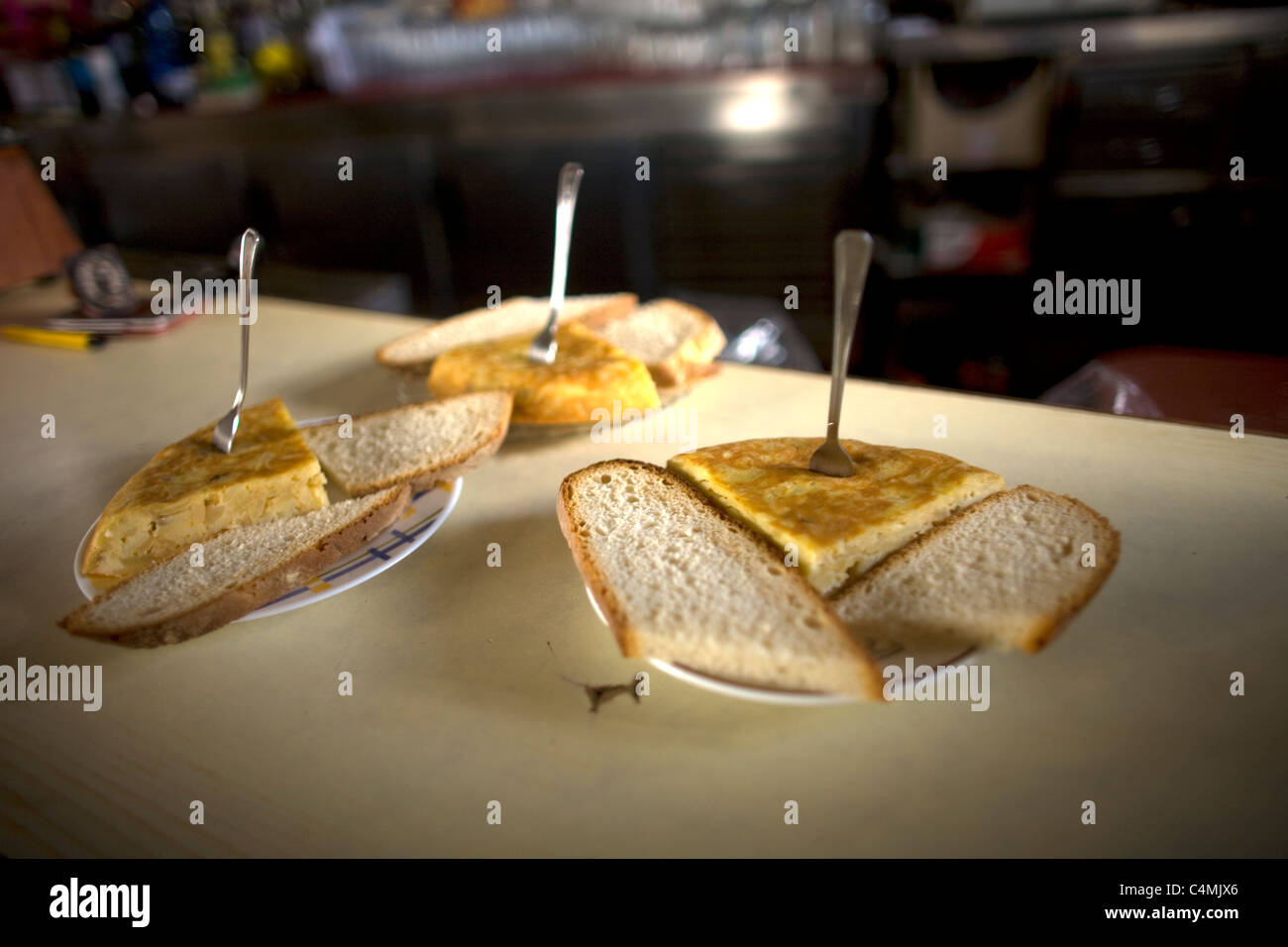 Spanish omelette or Spanish tortilla pieces for sale in a bar of the French Way, Way of Saint James, El Ganso village, - Stock Image