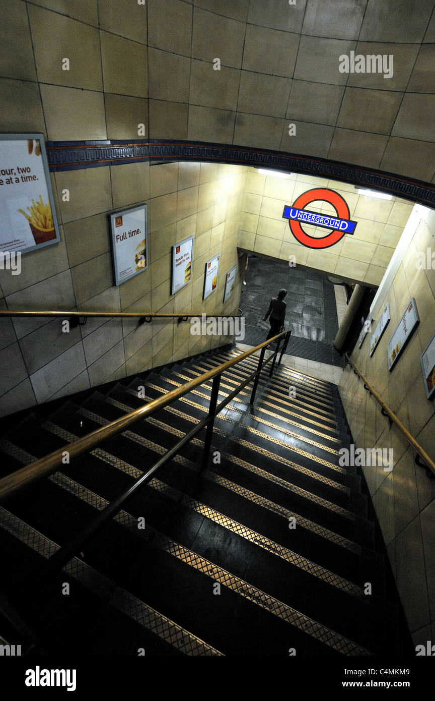 A commuter goes into Leicester Square tube station, London - Stock Image