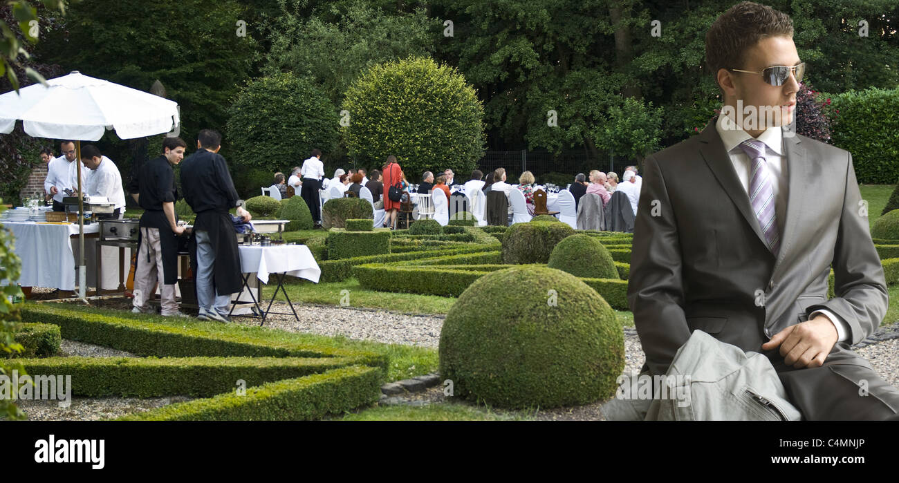 gardenparty with man in suit - Stock Image