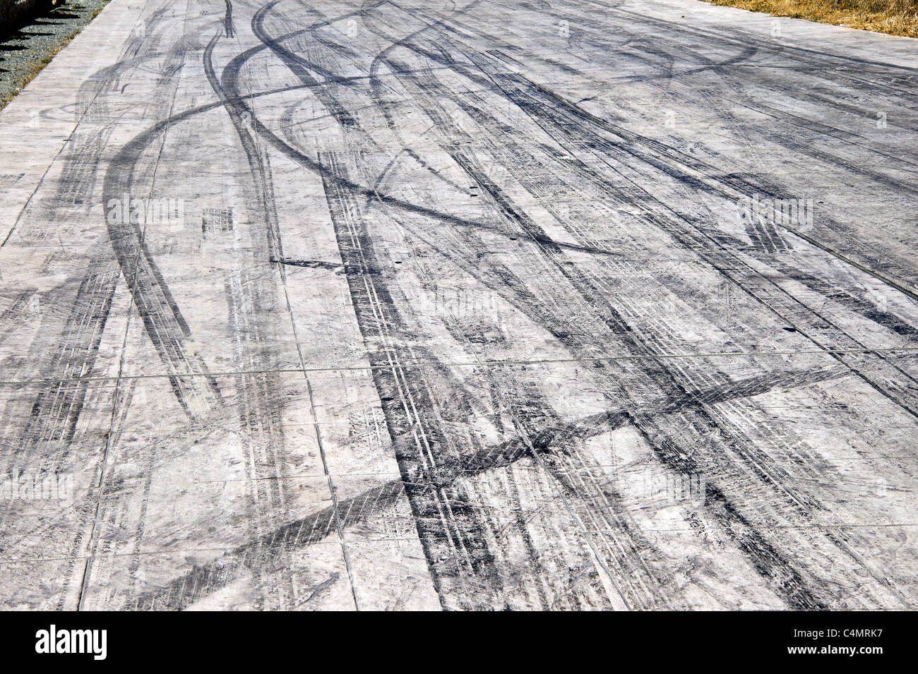 car tyre skid marks on road track - Stock Image