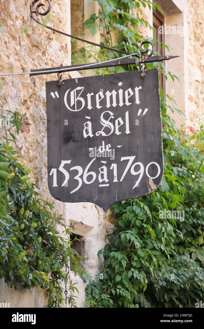 Sign reading Grenier a Sel de 1536 a 1790 on bed and breakfast accommodation entrance Rues des Rondes Perouges Burgundy - Stock Image