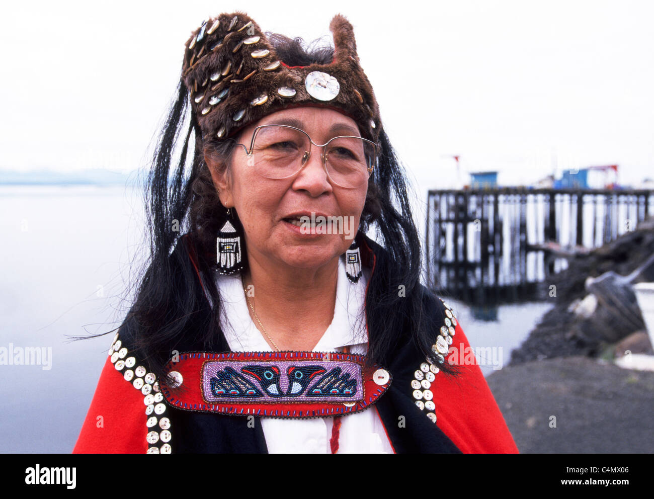 A Tlingit Native Alaskan woman wears her people's traditional dress in the village of Kake on Kupreanof Island - Stock Image