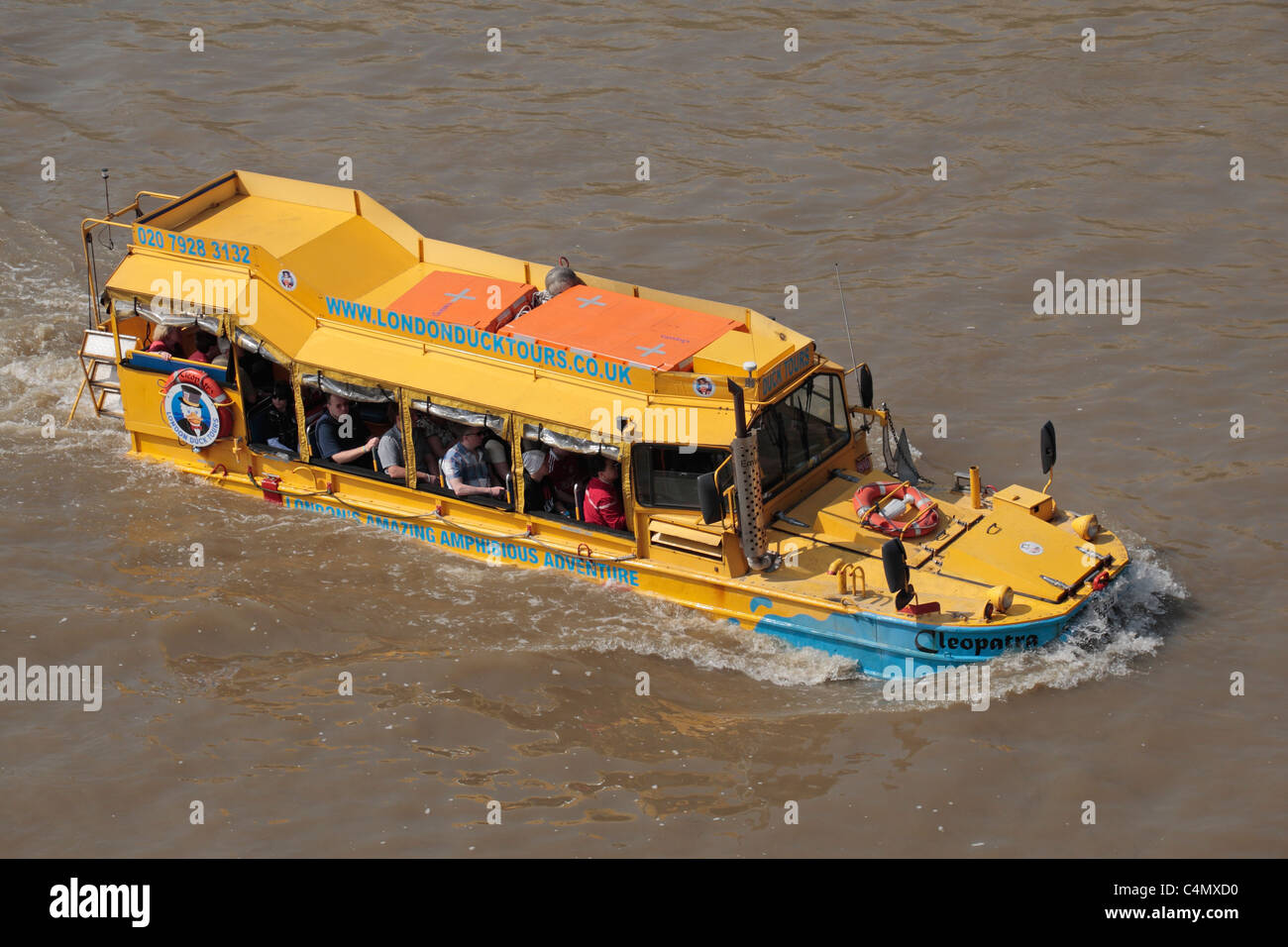 A WWII DUK-W amphibious vehicle (or Duck) converted into a tourist touring bus on the River Thames, London, UK. - Stock Image