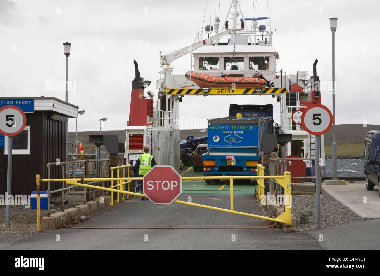 Belmont Ferry Terminal Unst Shetland Isles Scotland Barrier closed as loaded Yell to Fetlar ferry about to depart - Stock Image