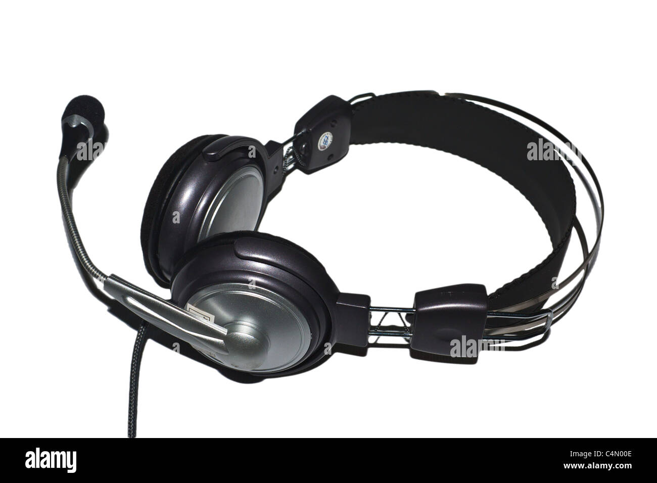 A headset with microphone in white background - Stock Image