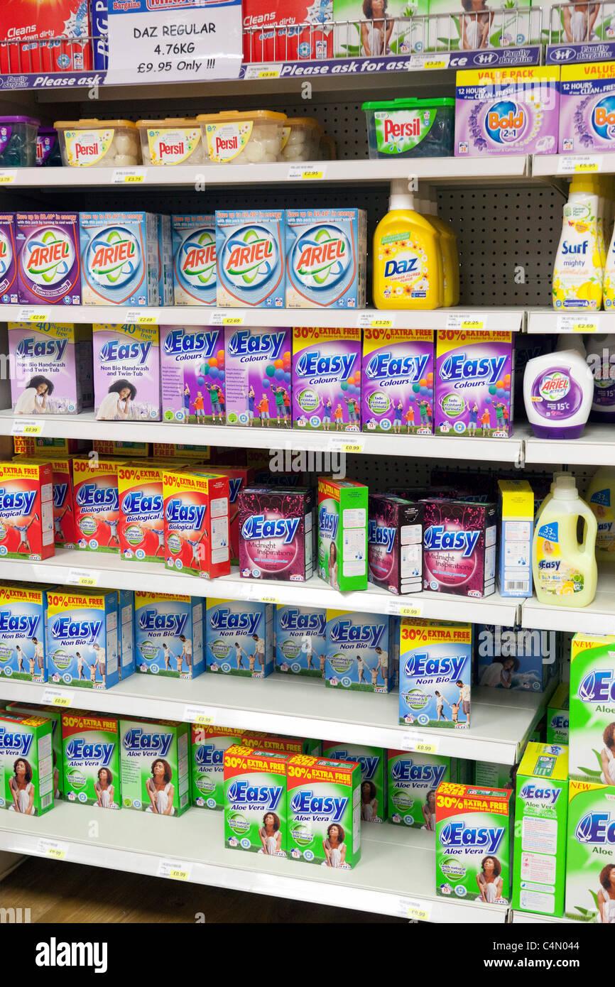 washing powders in shop shelf display, UK - Stock Image