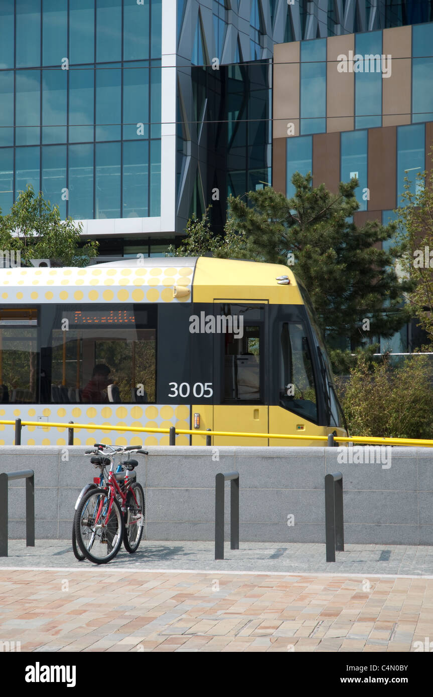 Metrolink tram at Media City UK, Salford Quays. - Stock Image