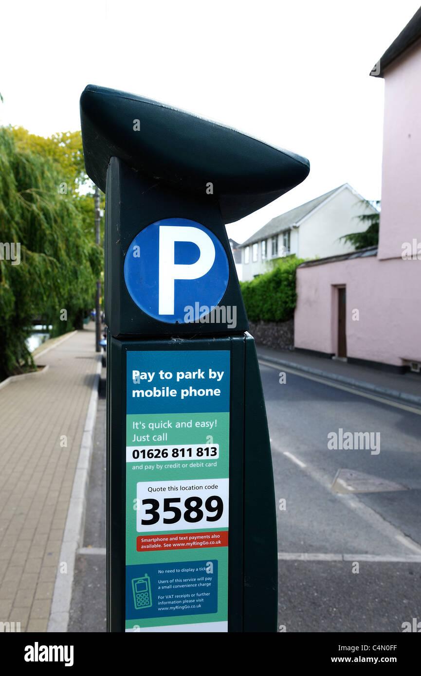 parking meter payable by mobile phone dawlish devon england uk - Stock Image