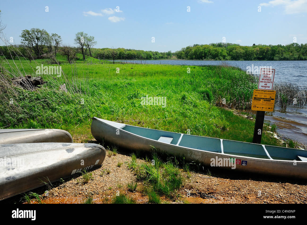 Rental canoes pulled onshore at Lake Defiance which is a glacial bog lake at Moraine Hills State Park in McHenry, - Stock Image