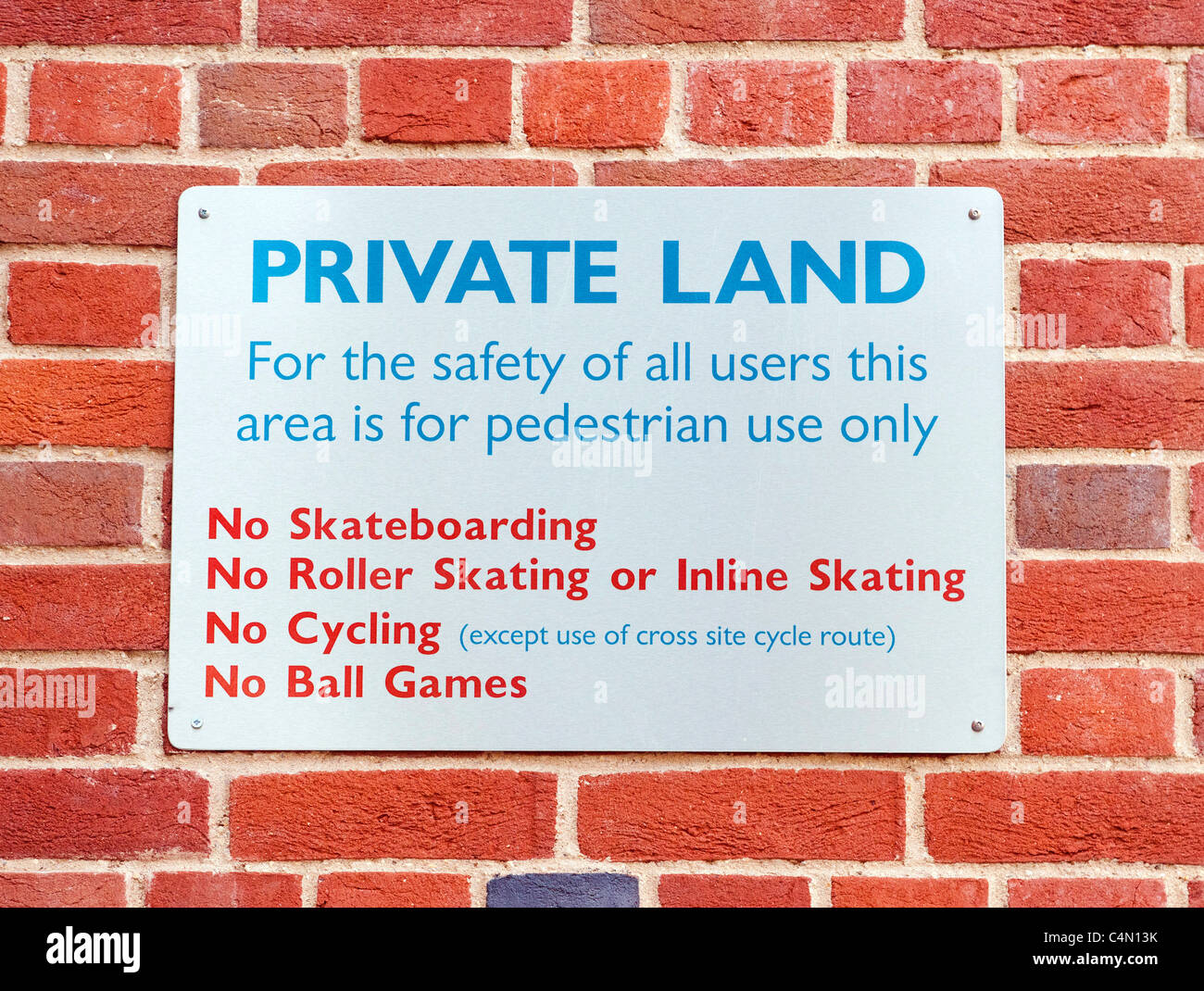 Private Land sign in a town centre banning various activities - Stock Image