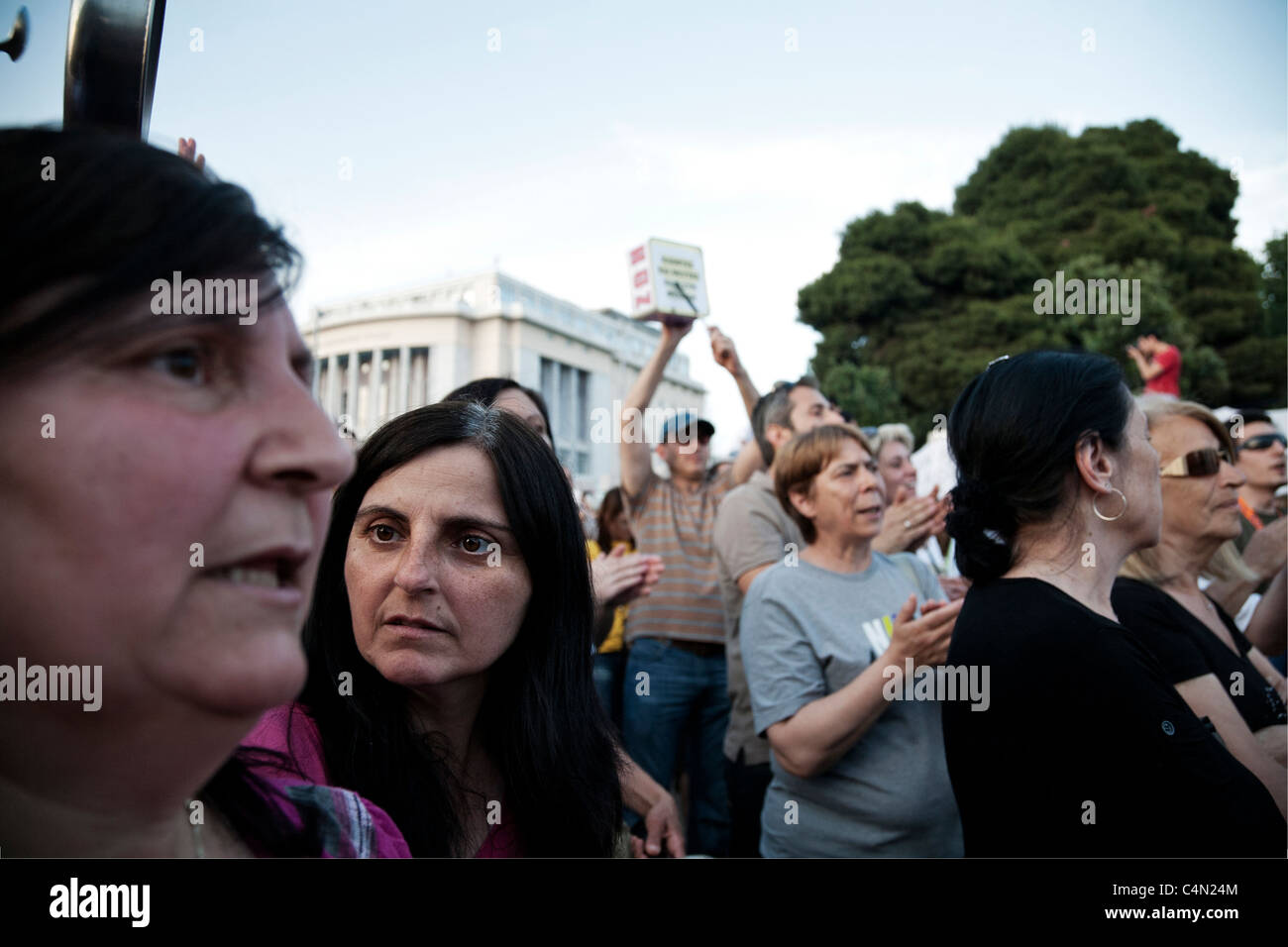 A glance full of dynamism and wonder through the yelling crowd. - Stock Image