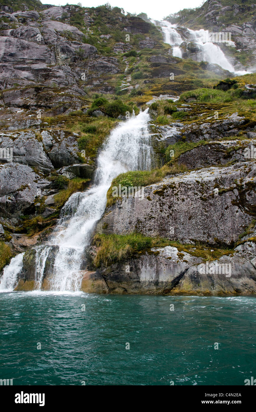 Runoff from a melting glacier in the Chilean Fjords in South America. - Stock Image