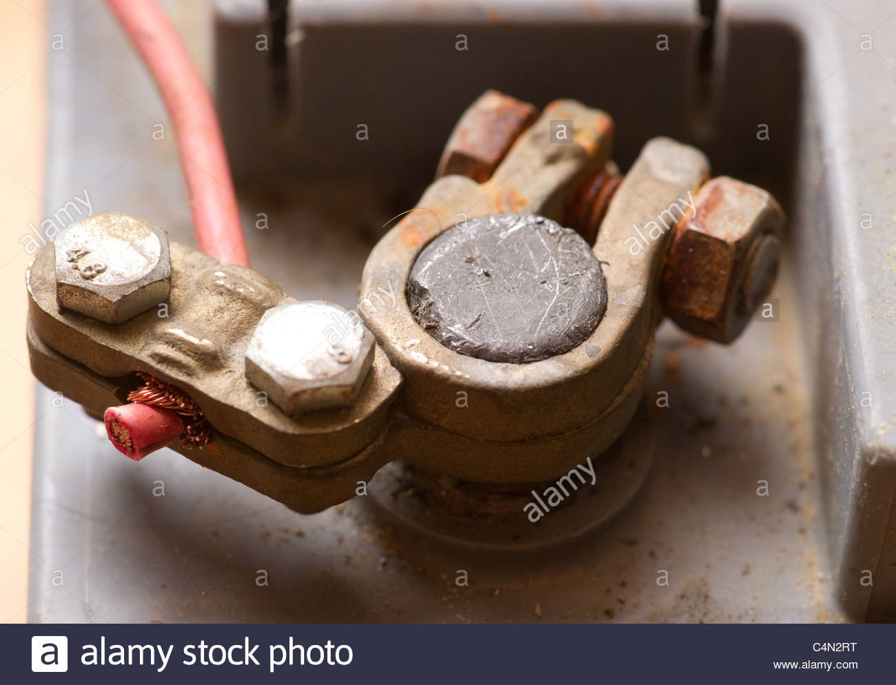 red battery positive connection wire clamp termin - Stock Image