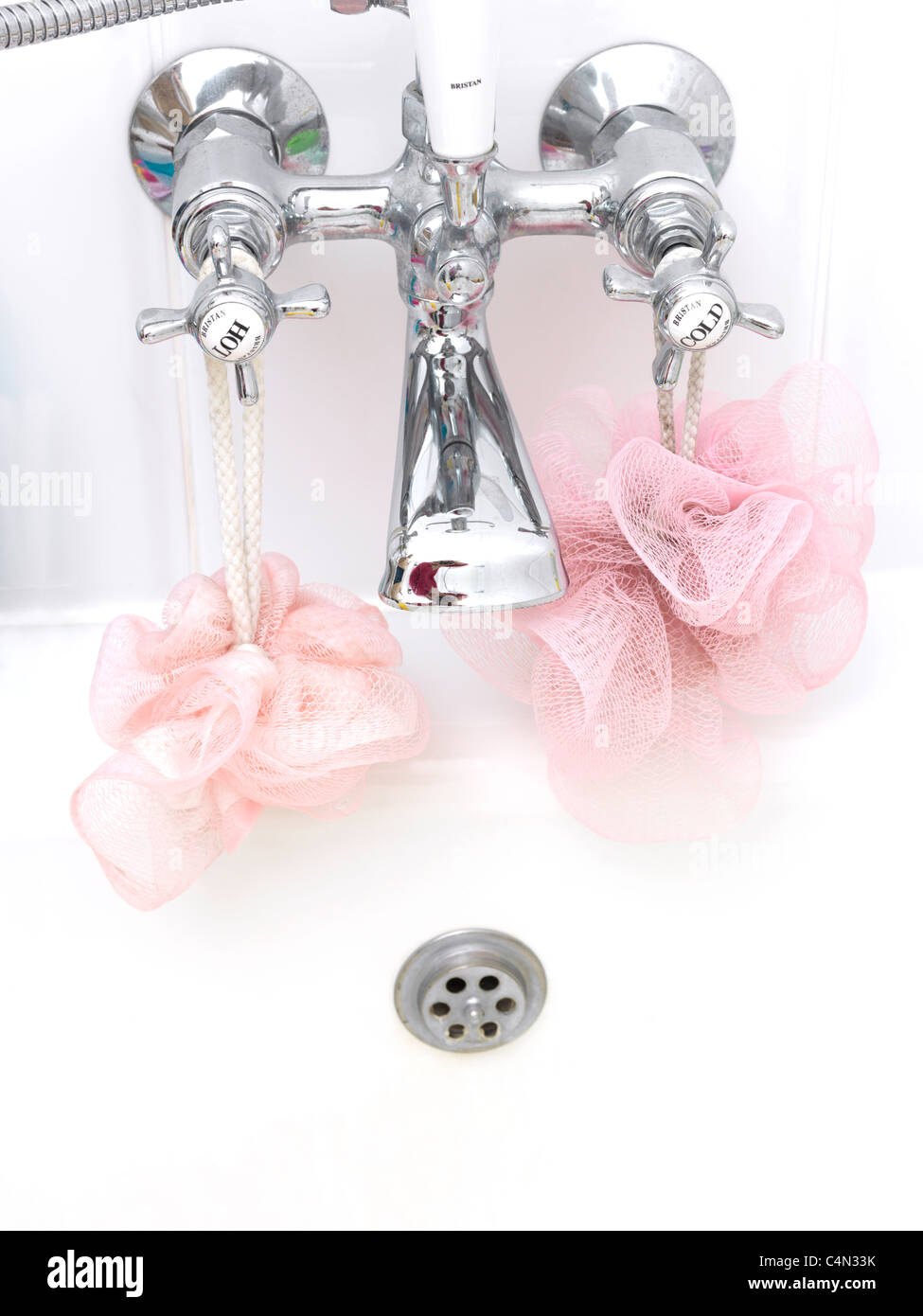 Bath Taps And Body Puffs In The Shape Of A Face Pareidolia Seeing Faces In Objects - Stock Image