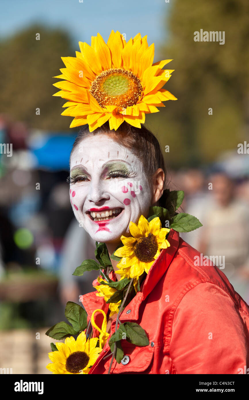 French clown with traditional white-painted face at market in La Reole, France - Stock Image