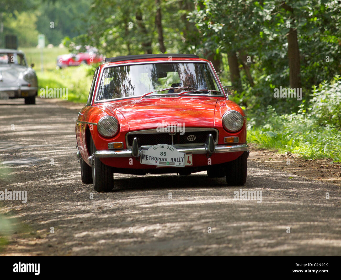 Bright red MGB GT participating in a classic car rallye in Belgium - Stock Image