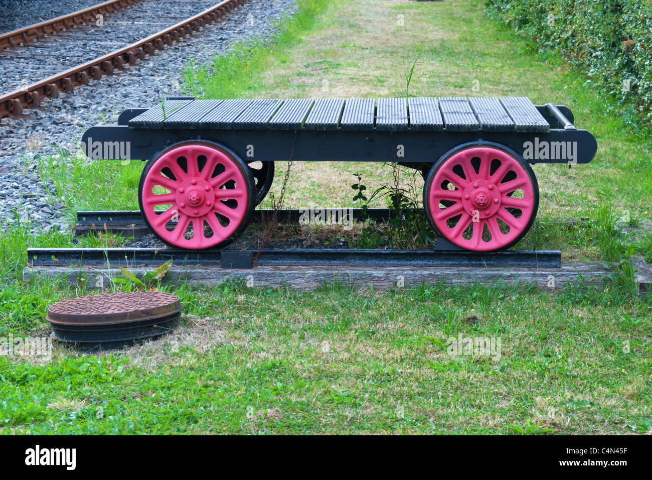 An old small flatbed train wagon - Stock Image