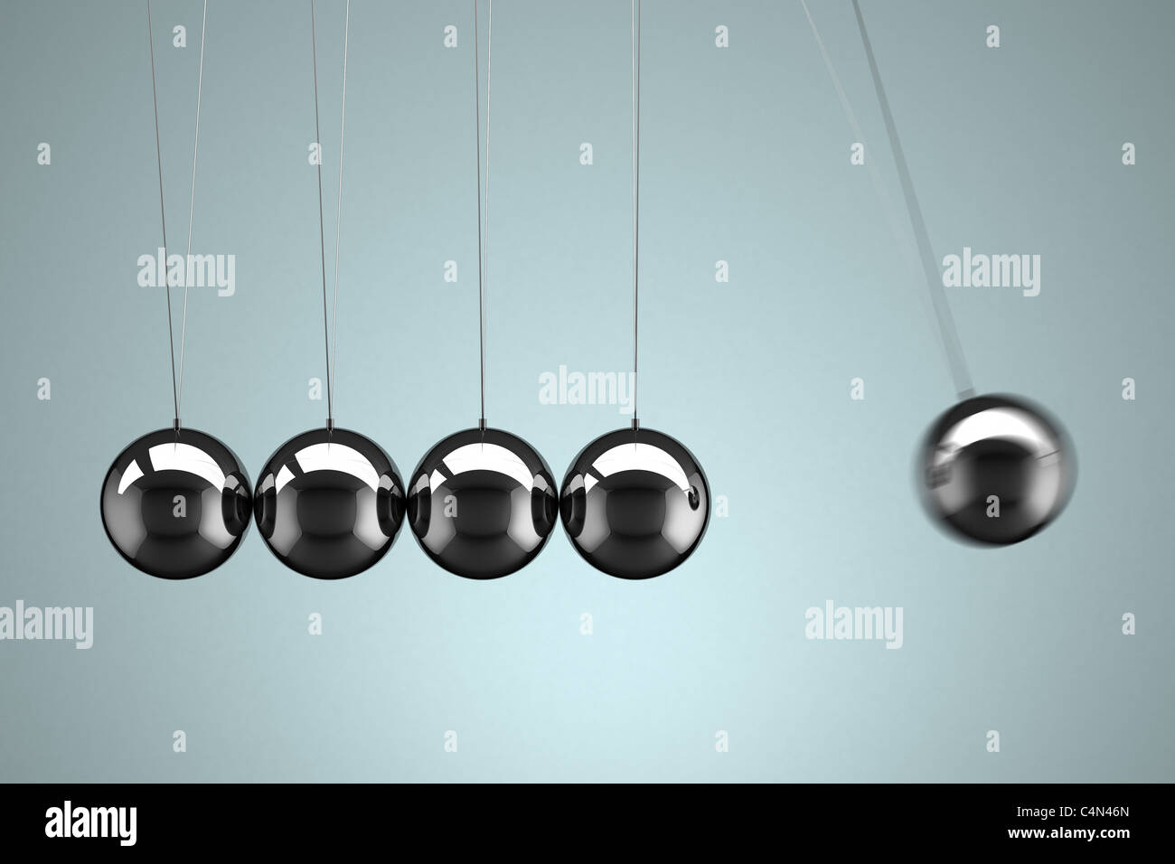 Newton's Cradle with motion blur - Stock Image
