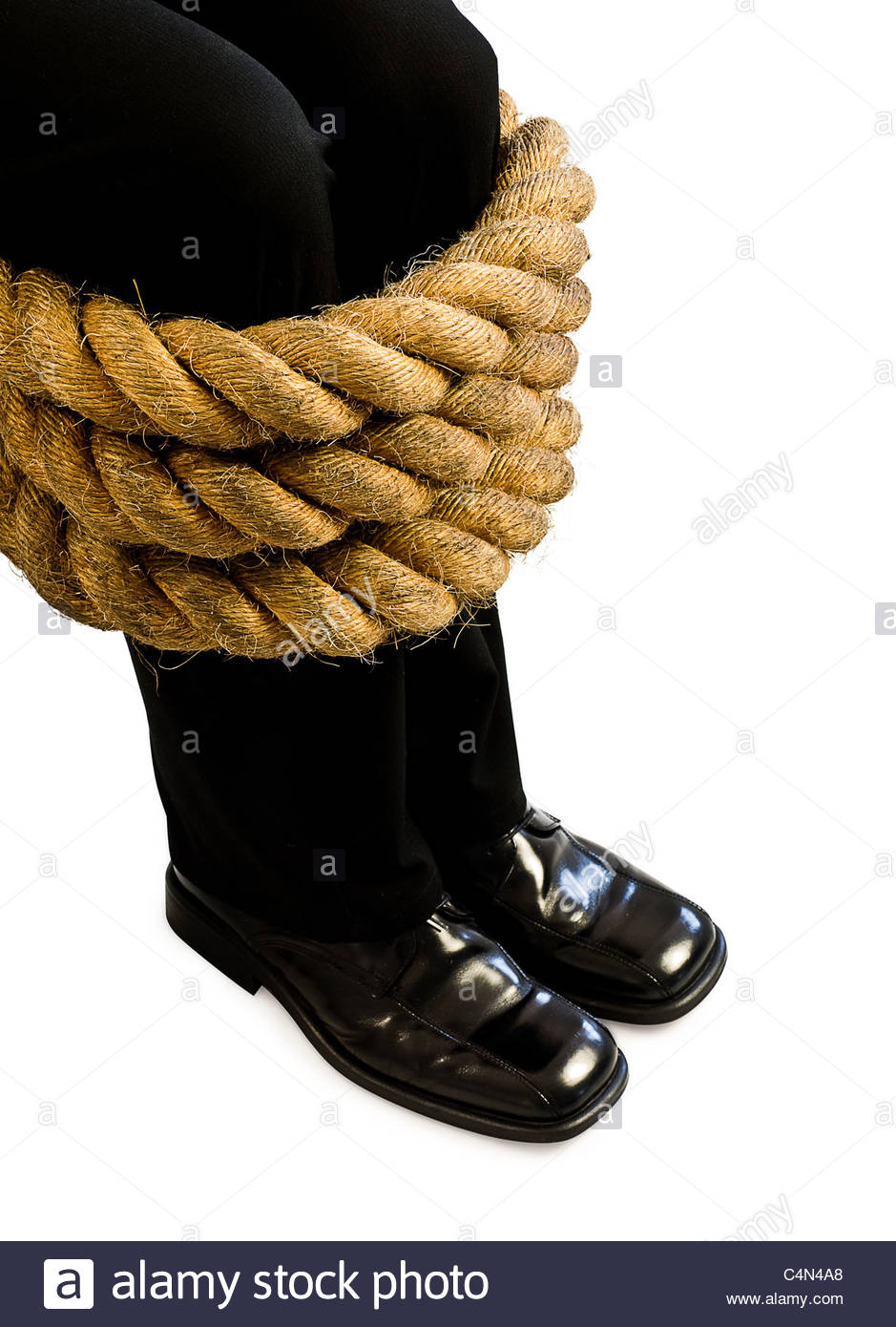 legs tied with rope - Stock Image