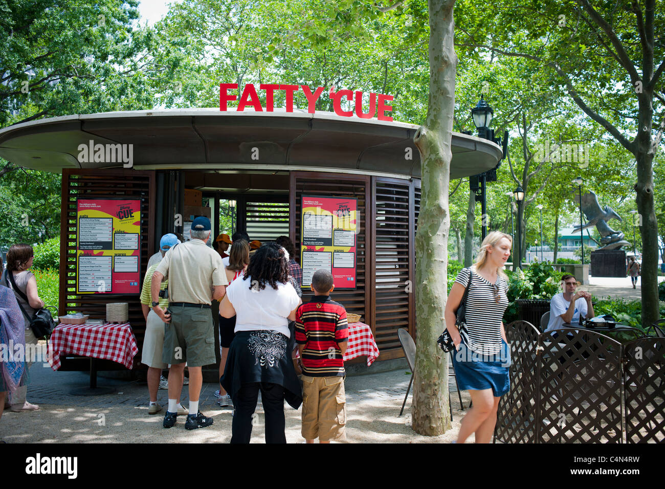 The Fatty 'Cue kiosk in the Battery Bosque section of Battery Park in Lower Manhattan in New York - Stock Image