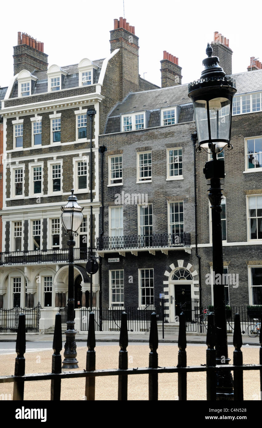 Bedford Square with railings, ornate lamppost and Georgian houses Bloomsbury WC1 London England UK - Stock Image