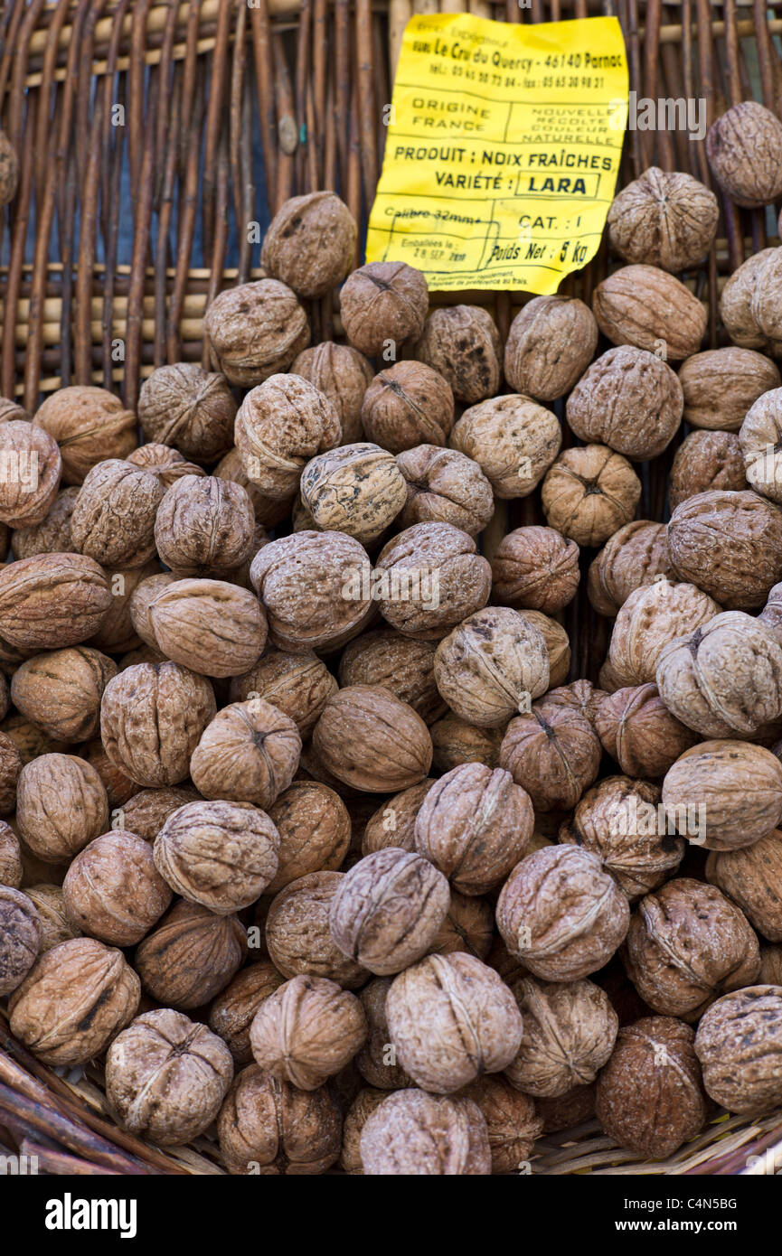 Fresh walnuts on sale at food market at La Reole in Bordeaux region of France - Stock Image
