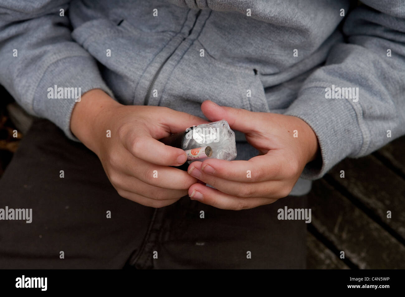Boy holding an open micro-cache - Stock Image