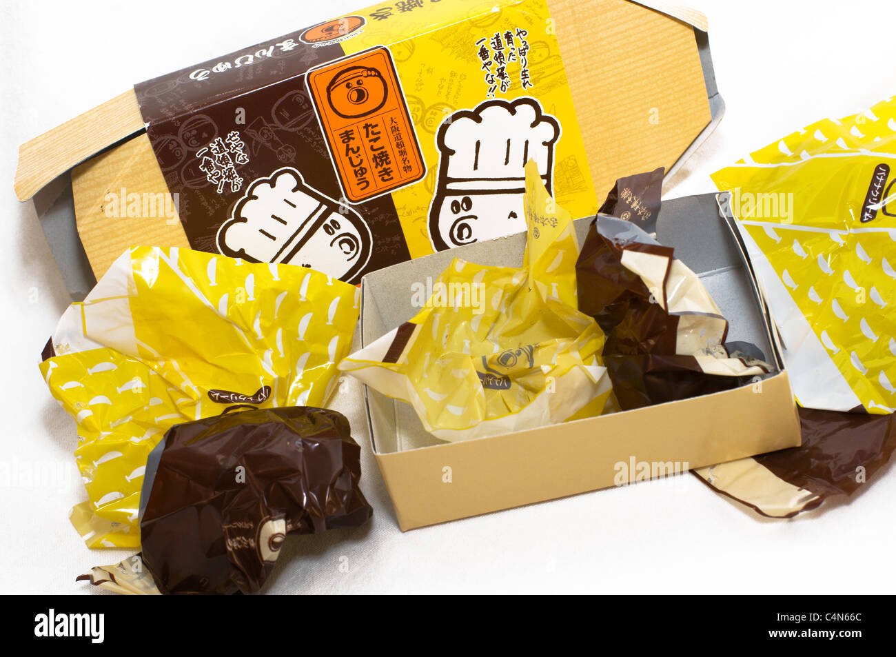 Empty wrappers and an open box are all that is left of this delicious Japanese dessert treat. - Stock Image