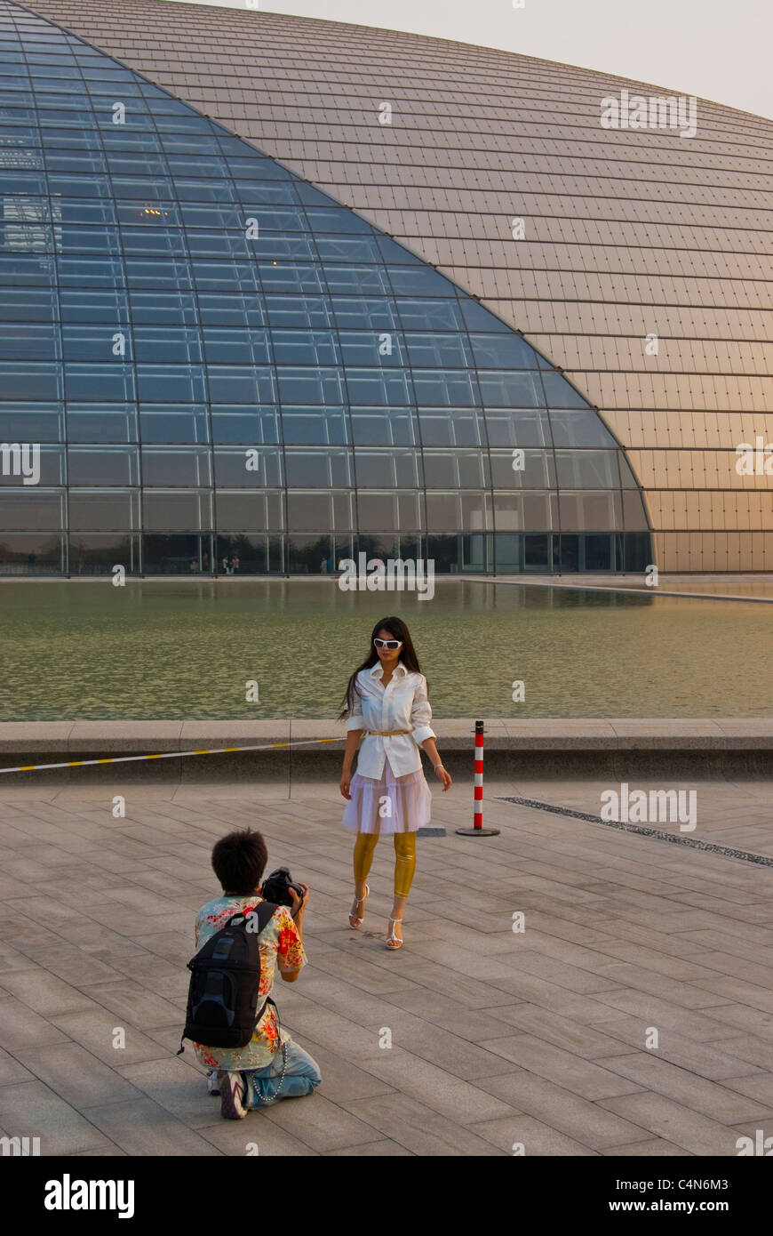 Beijing, China, Photographer Taking Photos Outside of the Grand National Theatre Building, Credit Architect: Paul Stock Photo