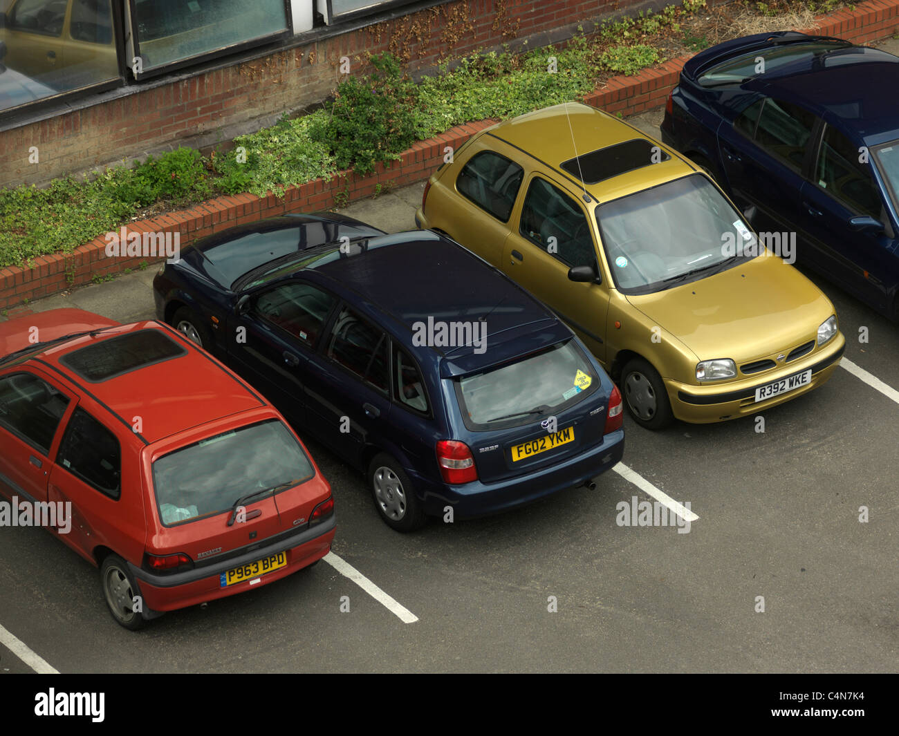 Row Of Cars In Car Park England - Stock Image
