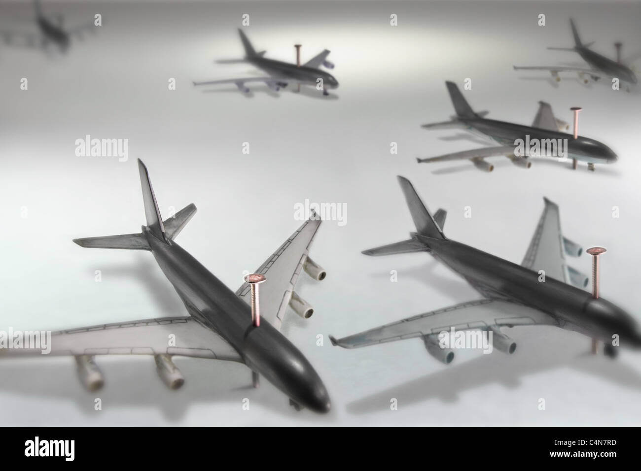 aircrafts grounded with nails like insects in the insectary, this symbolizes airline issues as strike, volcanic - Stock Image
