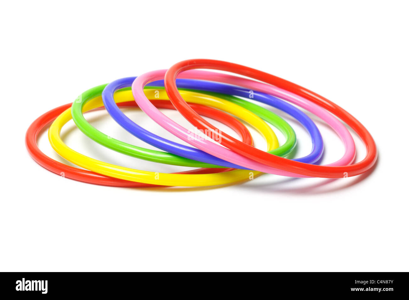 Multicolor plastic bangles isolated on white background - Stock Image