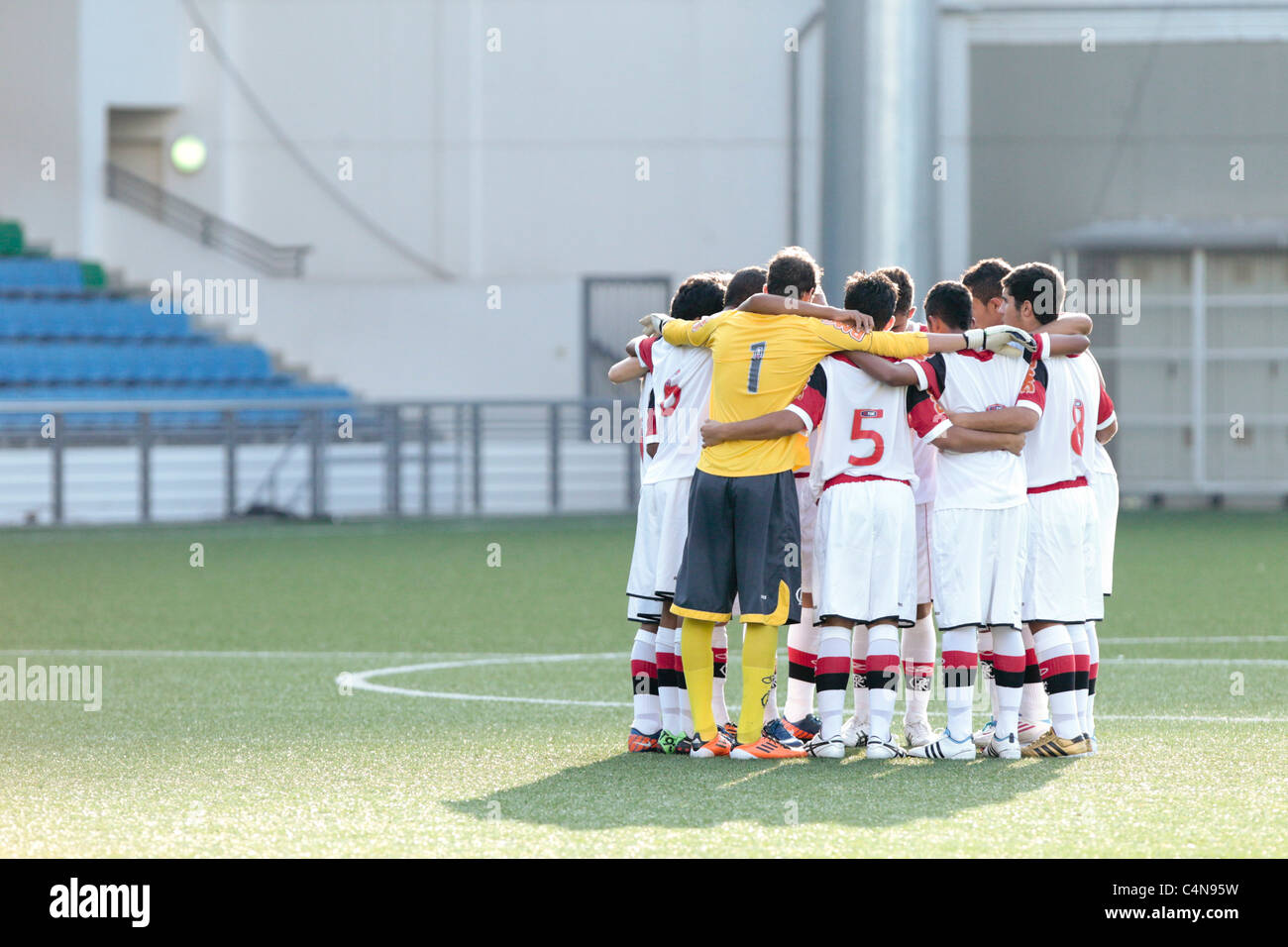 CR Flamengo U15 players huddle before their group match of the 23rd Canon Lion City Cup. - Stock Image