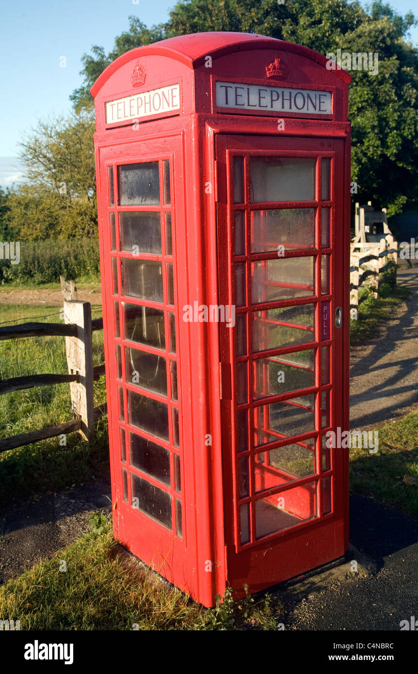 Traditional red telephone box in the countryside, Sussex, England - Stock Image