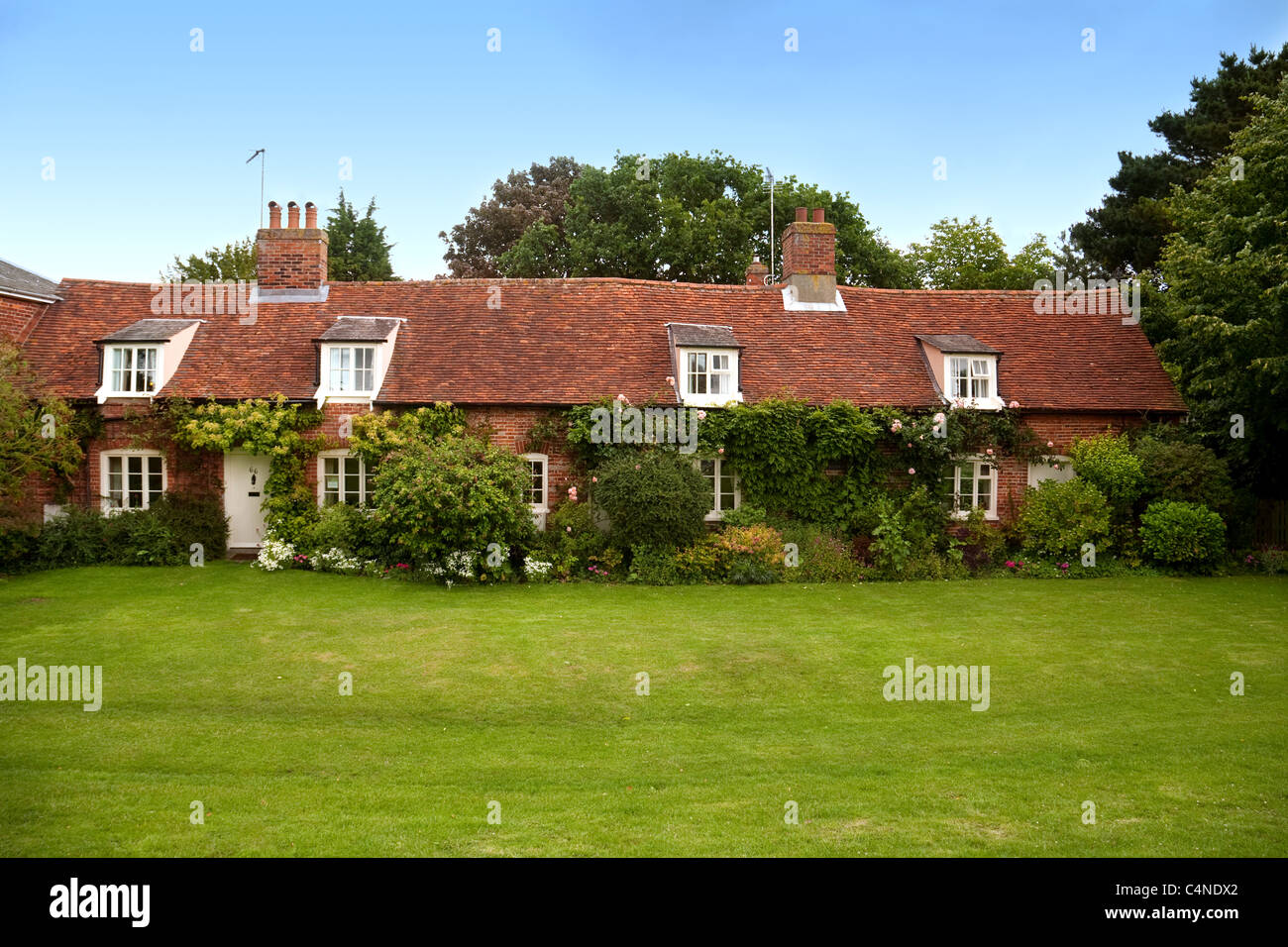 Cottages on the village green at Orford, Suffolk UK - Stock Image