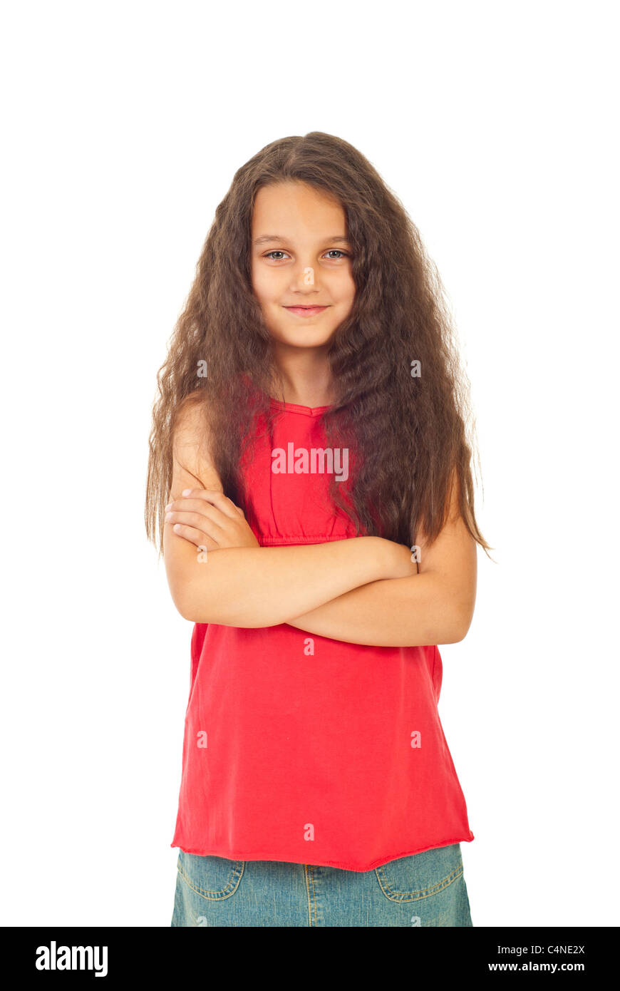 pretty girl seven years old with long curly hair standing with arms
