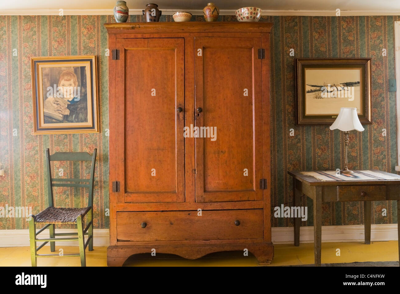 Antique armoire in bedroom of 19th century home, Quebec, Canada ...