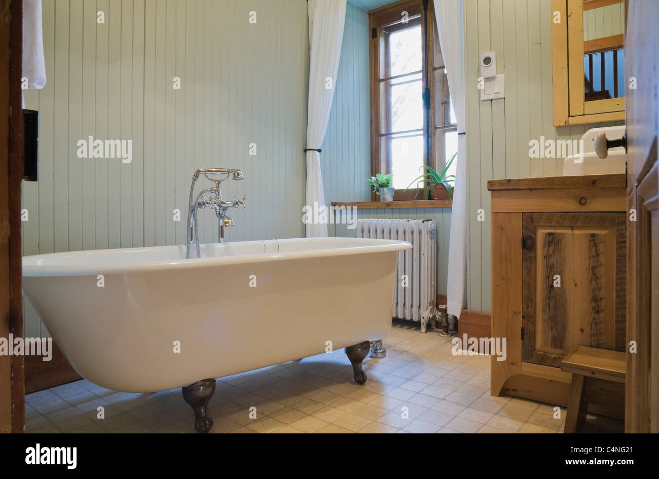 Bathroom with a roll top bathtub in 19th century home, Quebec ...