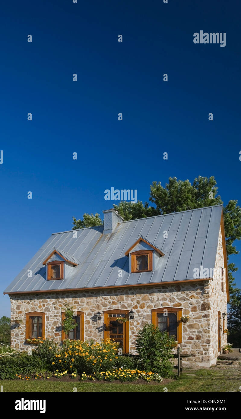 21st century replica of fieldstone cottage, Quebec, Canada - Stock Image