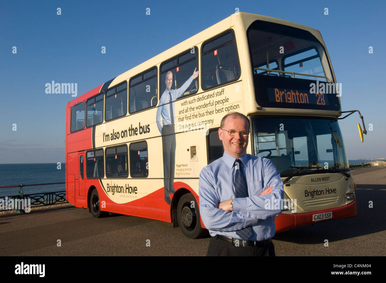 Roger French Managing Director of Brighton & Hove Bus & Coach Company , with one of his double decker buses. - Stock Image