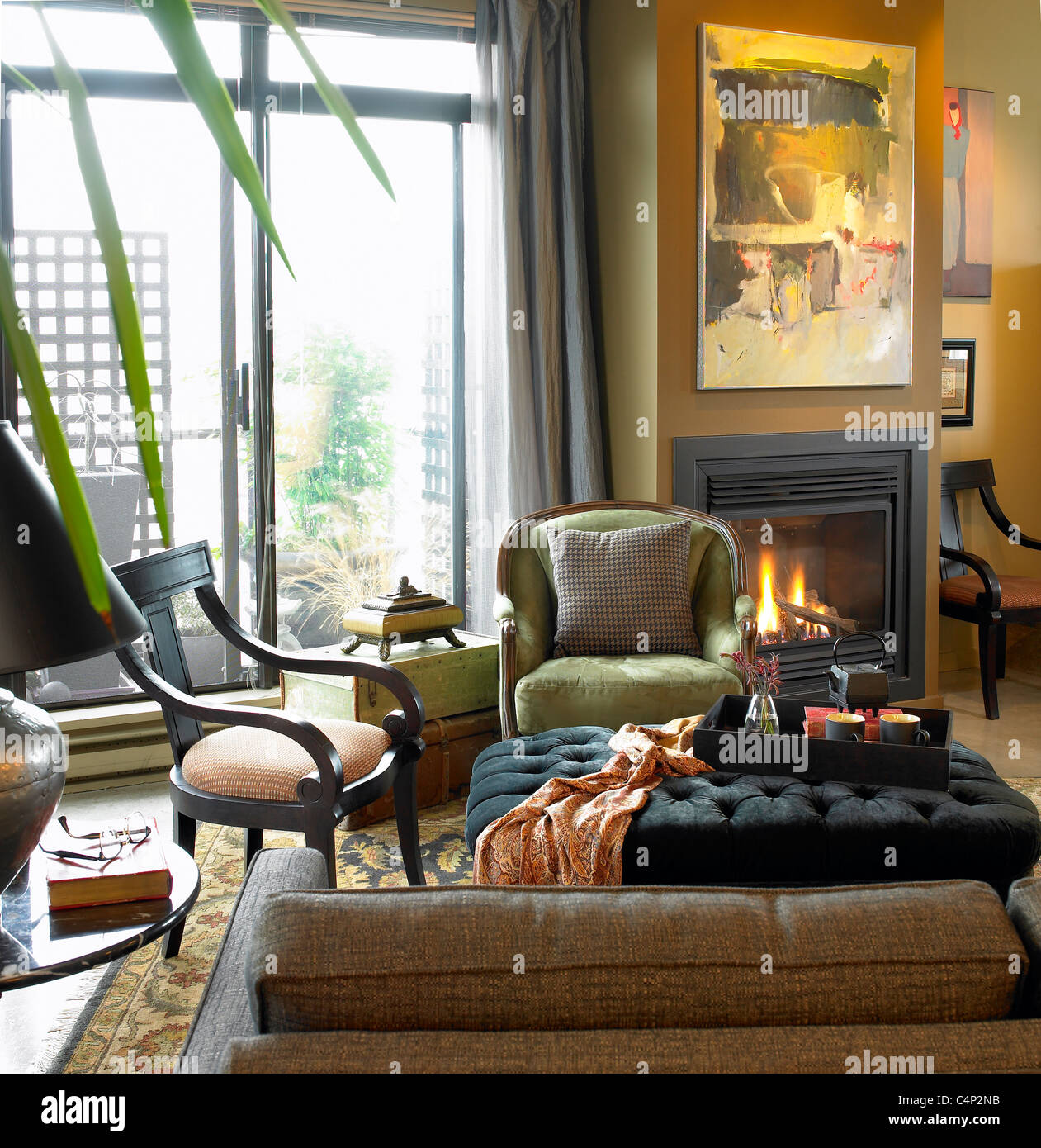 Condo living room with fireplace burning and patio doors open Victoria Vancouver Island B.C. Canada & Condo living room with fireplace burning and patio doors open Stock ...