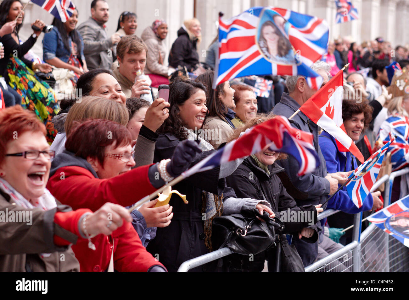 Royal Wedding 2011: Spectators wave flags on Whitehall Stock Photo