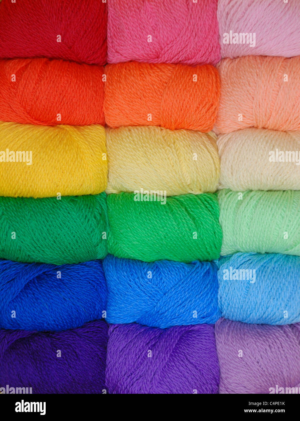 skeins of yarn in a spectrum of colors - Stock Image