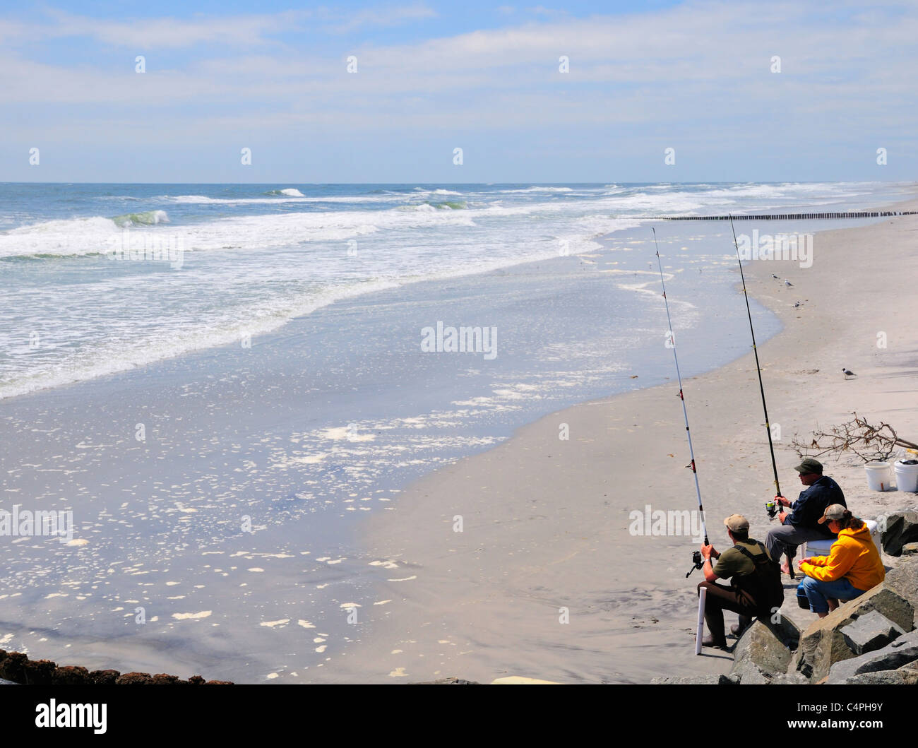 Anglers fishing from the beach at Brigantine Beach, New Jersey - Stock Image
